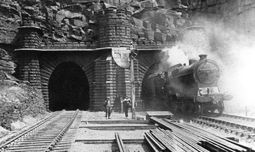 Black and white photograph of a train exiting a tunnel, courtesy Tameside Archive.